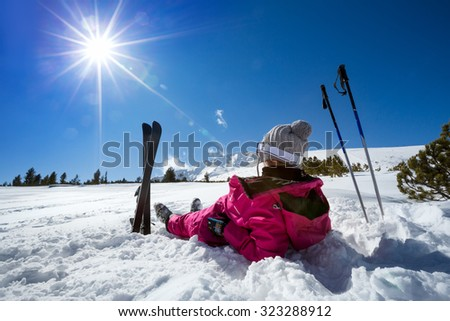 Woman skier enjoy in winter sunny day, holiday and relax - stock photo