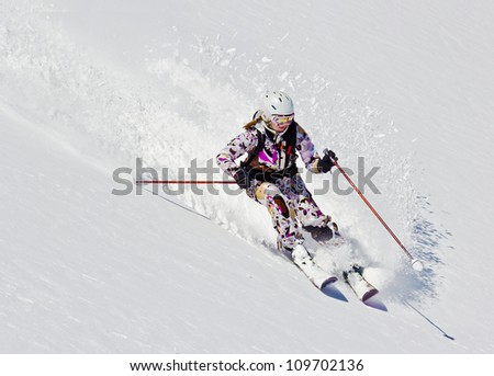 Woman skier in the soft snow - stock photo
