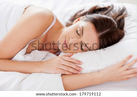 Woman sleeping. Beautiful young woman sleeping while lying in bed  - stock photo
