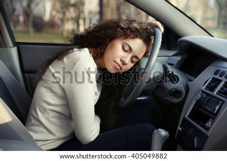 Woman sleeping in car