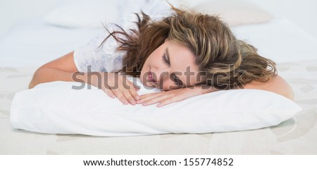 Woman sleeping in cosy bed at home
