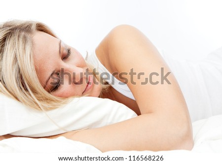 woman sleeping on her bed at home - stock photo