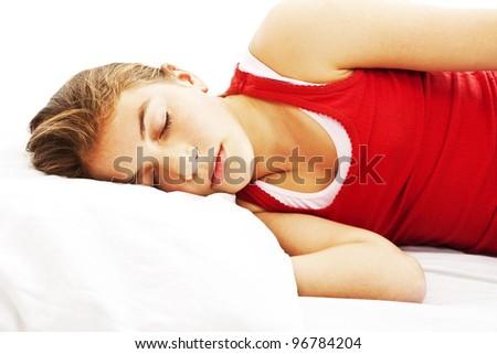Woman sleeping on white background - stock photo