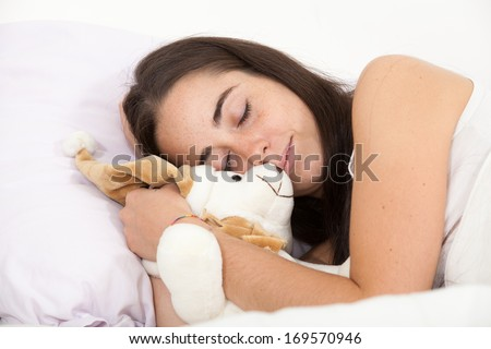 woman sleeping with a teddy bear