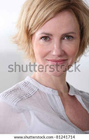 Woman smiling.