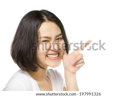 Woman smiling pointing up showing copy space isolated on white background.