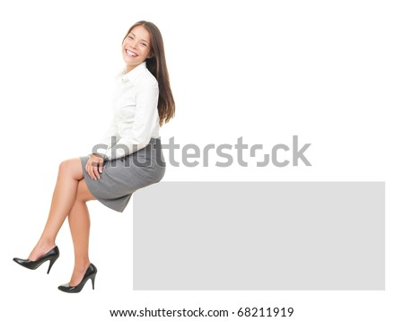 Woman smiling sitting on horizontal banner edge. Happy businesswoman showing sign with lot of copy space. Isolated on white background in full body. - stock photo