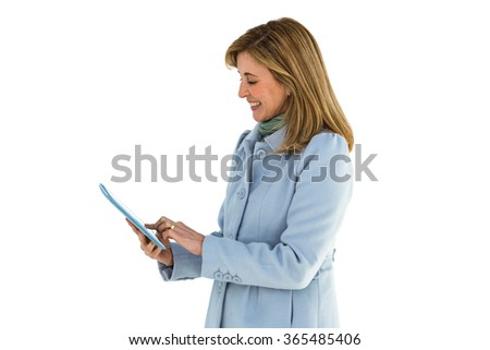 Woman smiling using her tablet