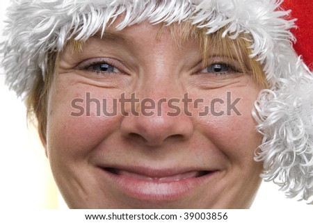 Woman smiling with a santa claus hat on