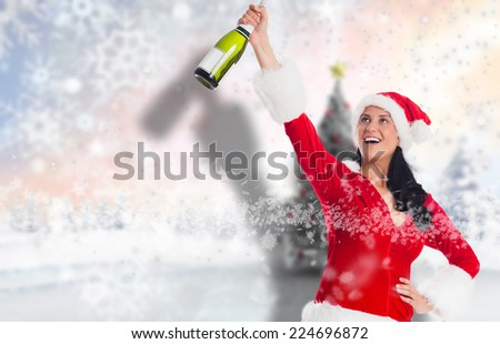Woman smiling with christmas presents against blurry christmas scene - stock photo