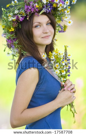woman smiling with diadem and bunch in field - stock photo