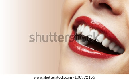 Woman smiling with great teeth on white background - stock photo