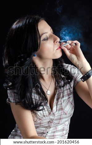 Woman Smoking a Cannabis Joint - stock photo