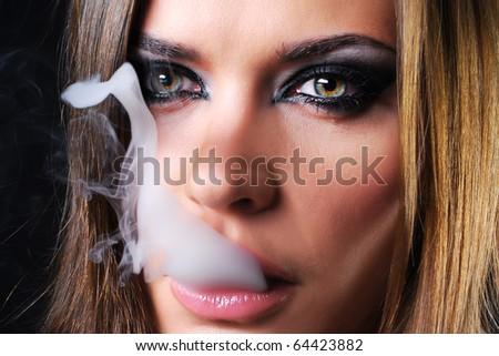 Woman smoking a cigarette macro shot - stock photo