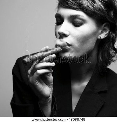 Woman smoking cigars. Studio fashion photo - stock photo