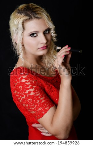 Woman smoking with electronic cigarette  - stock photo