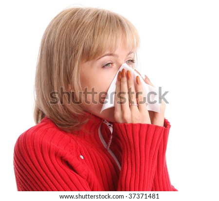 Woman sneezing isolated on white