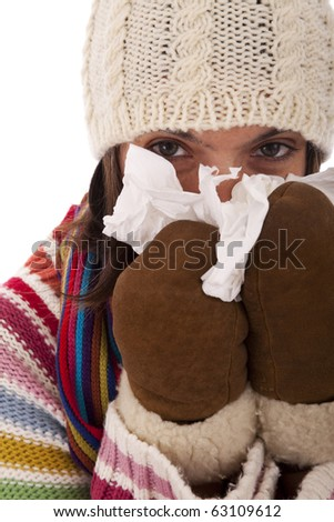 woman sneezing to a paper tissue in winter (isolated on white) - stock photo