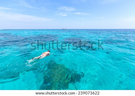 Woman snorkling at Similan Island .Andaman sea thailand, Great for discover plenty of fishes and corals - stock photo