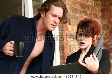 Woman solicitor at man's doorstep in morning making sales pitch. - stock photo