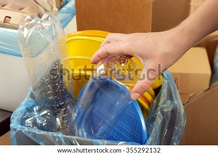 Woman sorting waste, close-up