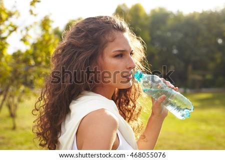 woman sport holding bottle with water.