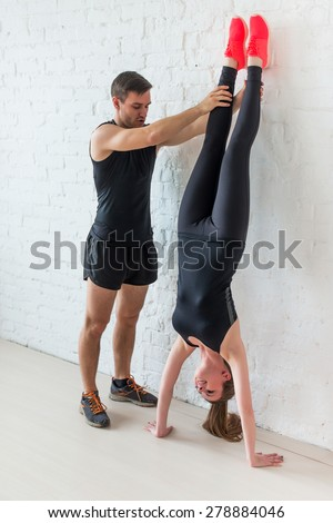 how to sit in a handstand against the wall