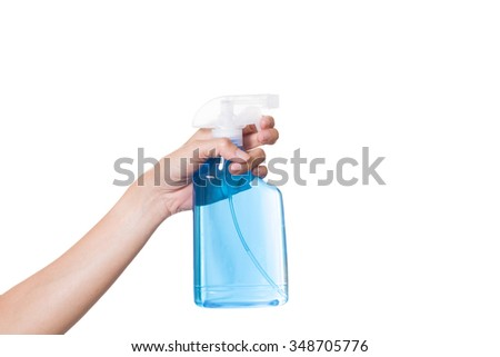 woman spraying cleaning liquid on white background - stock photo