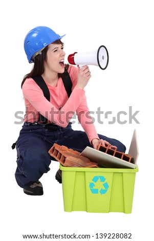 Woman spreading the message about recycling - stock photo