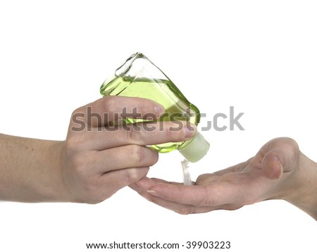 Woman squeezing green hand sanitizer lotion onto her hands. - stock photo
