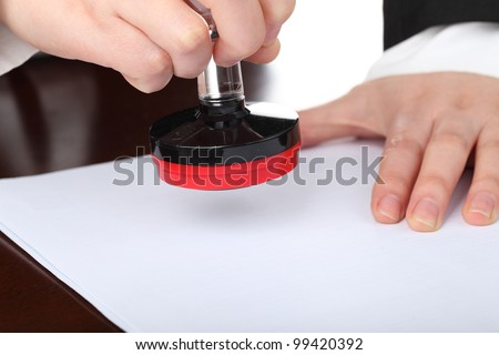 Woman stamping a document - stock photo