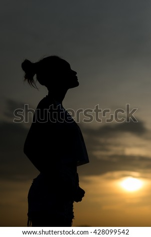 Woman stand and stare at the sky