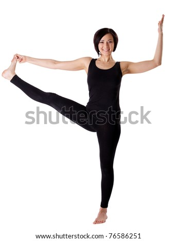 woman stand in yoga Tree pose isolated - stock photo