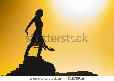 woman standing agains the sun - stock photo