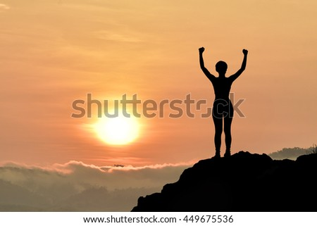 woman standing alone at the field during beautiful sunset.