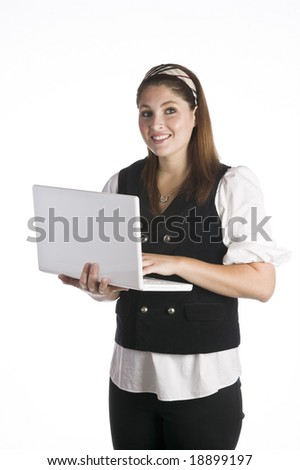 Woman standing and using a laptop isolated against white