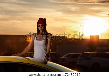 woman standing at the car - stock photo