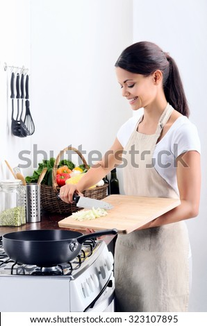 Woman Standing By Stove Kitchen Cooking Stock Photo 323107895 ...