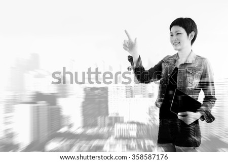 woman standing double exposure with blur building in black and white filter - stock photo