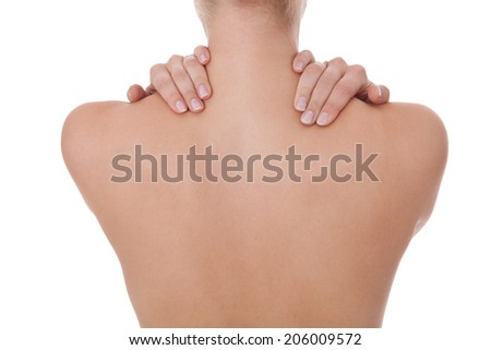 Woman standing facing away caressing her bare shoulder and tanned toned back with her fingers in a sensual portrait of a nude female back and spine, isolated on white - stock photo