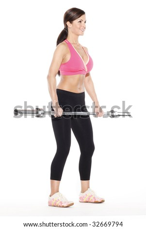 Woman Standing Holding Barbell - stock photo