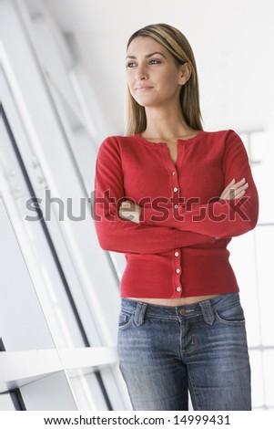 Woman standing in corridor - stock photo