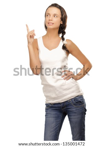 Woman standing isolated on white background and pointing at something. - stock photo
