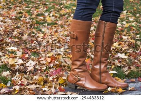 Woman standing on foliage - stock photo