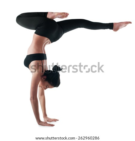 Woman standing on her hands - stock photo