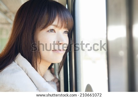 Woman Standing On The Train