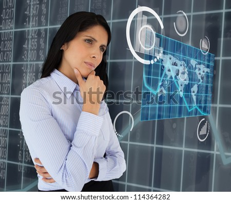 Woman standing thinking arms crossed looking at world map hologram