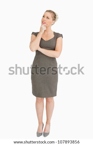 Woman standing while looking up something against white background - stock photo