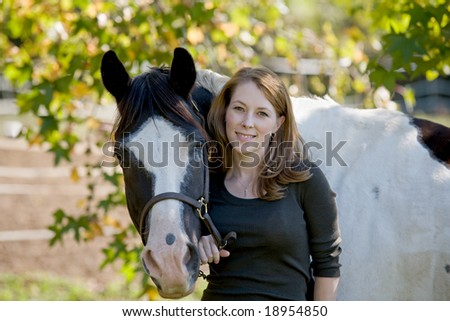Woman Standing With Horse