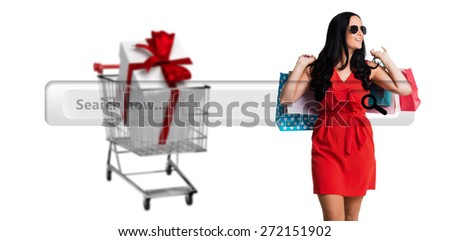 Woman standing with shopping bags against search engine - stock photo